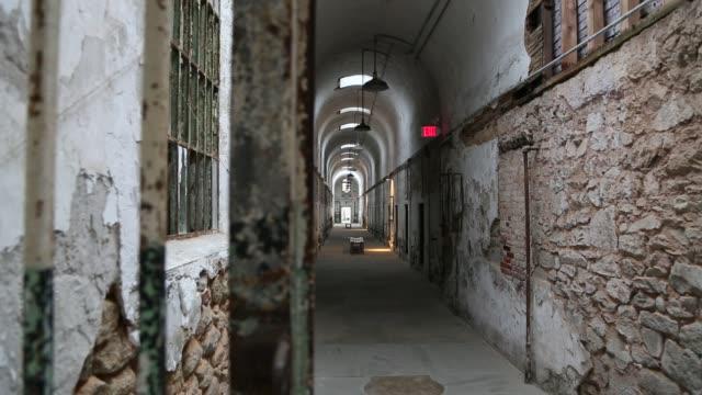 slider shot behind bars at eastern state penitentiary, philadelphia - eastern state penitentiary stock videos & royalty-free footage