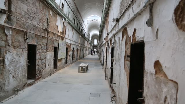 slider shot of corridor at eastern state penitentiary - public building stock videos and b-roll footage