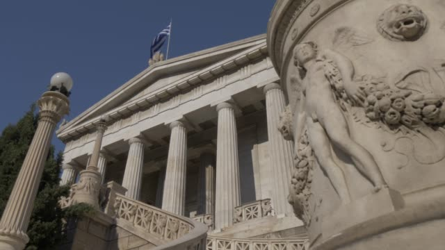 slider shot of national library of greece, athens, greece, europe - griechische flagge stock-videos und b-roll-filmmaterial