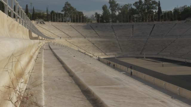 vídeos y material grabado en eventos de stock de slider shot of panathenaic stadium restored for the first modern olympics in 1896, athens, greece, europe - athens greece