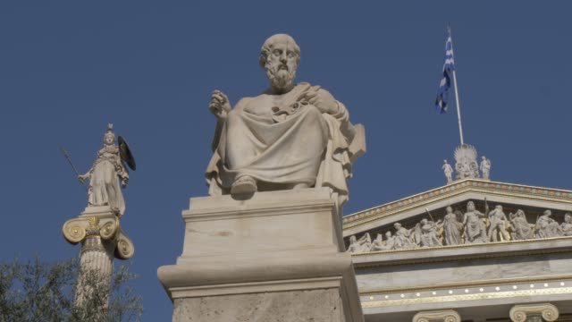 slider shot of the statues and facade of academy of athens, athens, greece, europe - greek flag stock videos & royalty-free footage
