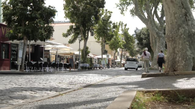 Slider shot view of cafes on promenade in Funchal, Madeira, Portugal, Atlantic, Europe