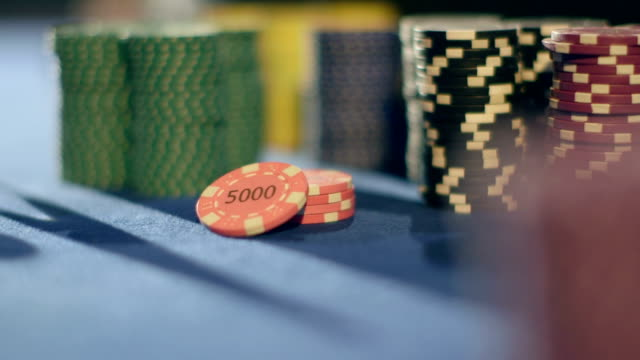 sliding cu of casino chips piled on the table - gambling chip stock videos and b-roll footage