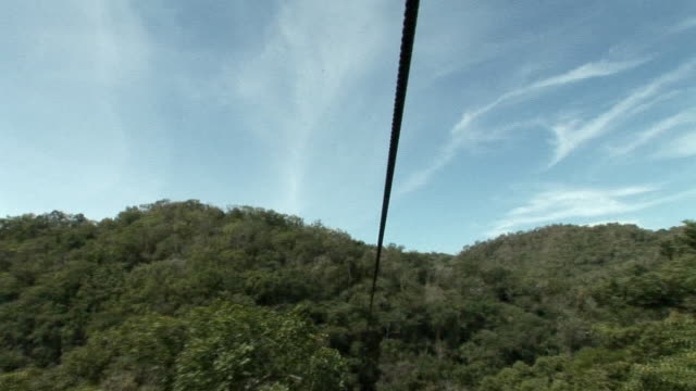 POV, Sliding down zipline over green hills, Mexico