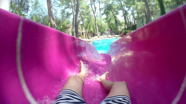 pov: sliding in a water park - water slide stock videos & royalty-free footage