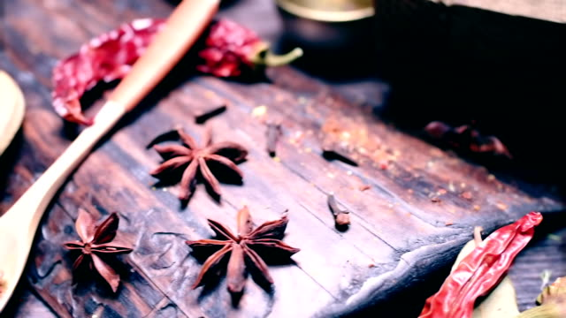 sliding on spices and herbs cooking table - star anise stock videos and b-roll footage