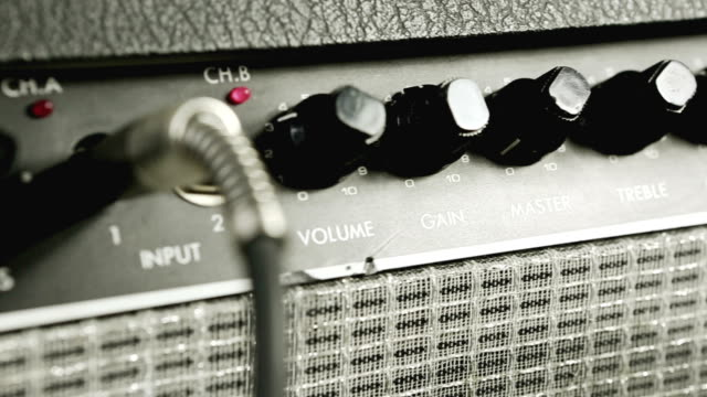 sliding view on amplifier knobs and plugs - amplifier stock videos & royalty-free footage