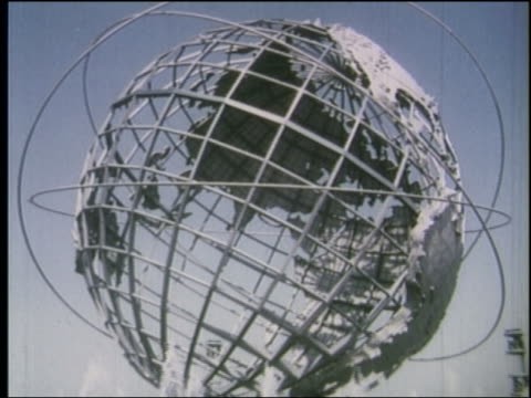 vídeos de stock, filmes e b-roll de 1964 slight point of view around unisphere at ny world's fair - 1964