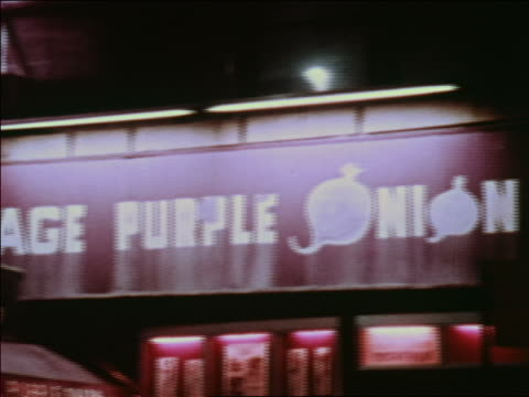 "1969 slight pan ""purple onion"" sign at night / greenwich village, nyc / industrial - greenwich village stock videos & royalty-free footage"