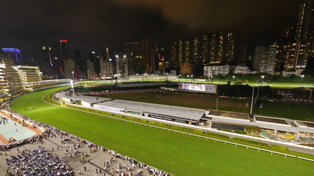 tl slight zoom-in hong kong happy valley horse race course at night. - spoonfilm stock-videos und b-roll-filmmaterial