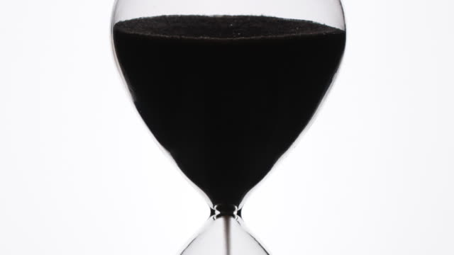 Slihouette of an hour glass timer
