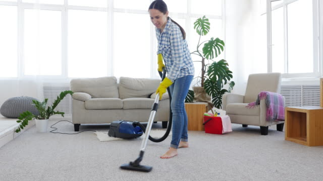 slim woman cleaning carpet - hovering stock videos & royalty-free footage