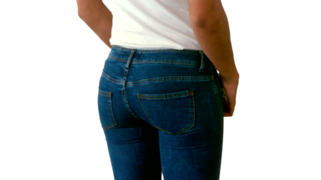 Slim woman in jeans turning