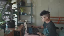 Slo mo : Asian Indie man Working From Home using laptop in the bed room.