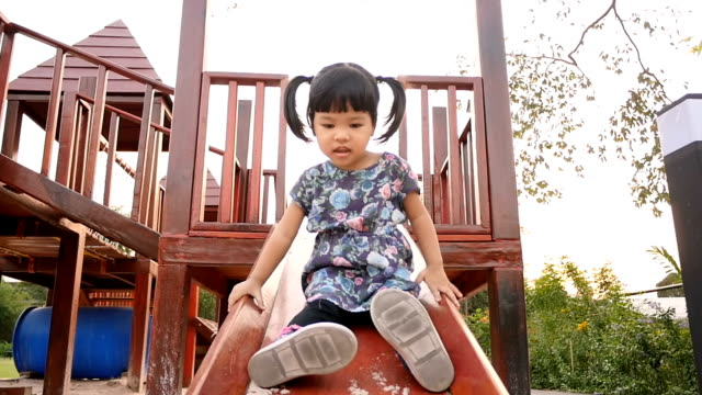 slo mo baby girls at the playground - sliding stock videos and b-roll footage