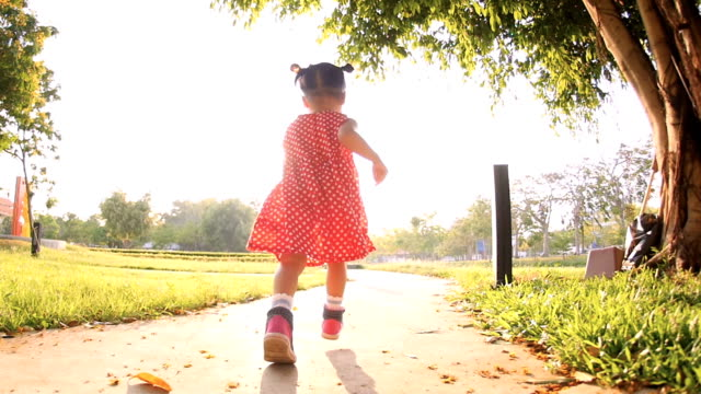slo mo baby girls running during sunset in the park - following moving activity stock videos and b-roll footage