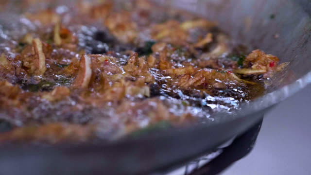 slo mo fried food - kitchenware shop stock videos & royalty-free footage