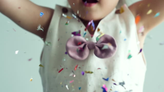 slo mo : mixed-race girl throwing colorful paper piece - 2 3 years stock videos & royalty-free footage