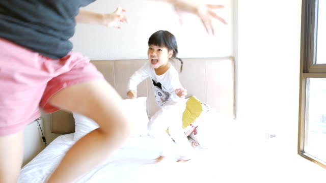 slo mo mother and daughter playing on the bed - toddler stock videos & royalty-free footage