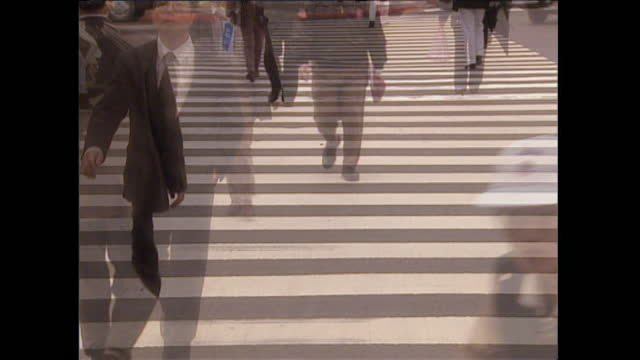 slo mo pedestrians crossing city street in kuala lumpur; 1996 - kuala lumpur stock videos & royalty-free footage