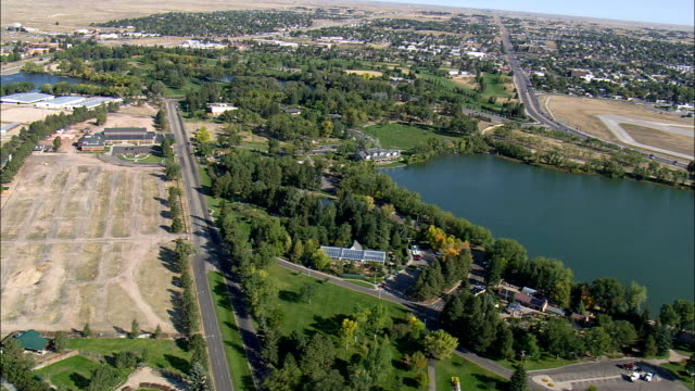 sloan lake and  cheyenne botanic gardens - aerial view - wyoming, laramie county, united states - wyoming stock videos & royalty-free footage