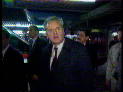 slobodan milosevic handed over to war crimes tribunal; lib milosevic along track as denies involvment in war crimes sot - slobodan milosevic stock-videos und b-roll-filmmaterial