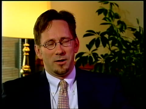 slobodan milosevic held for crimes against humanity; itn netherlands: the hague int clint williamson interview sot - milosevic wasn't issuing orders,... - slobodan milosevic stock-videos und b-roll-filmmaterial