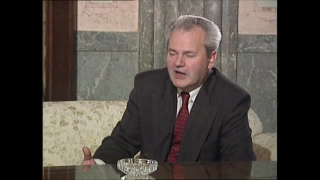 slobodan milosevic interview: part one; yugoslavia: serbia: belgrade: int slobodan milosevic interview sot q: how do you answer the accusation that... - montenegro stock videos & royalty-free footage