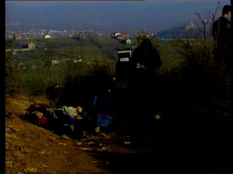 slobodan milosevic trial lib kosovo racak seq bodies found of ethnic albanians massacres on hillside - slobodan milosevic stock videos and b-roll footage