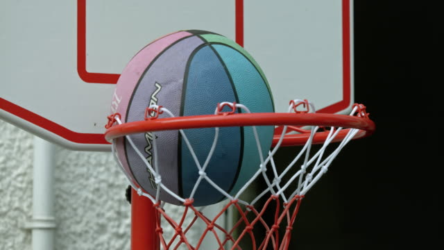 slomo basketball going through hoop - sports equipment stock videos & royalty-free footage