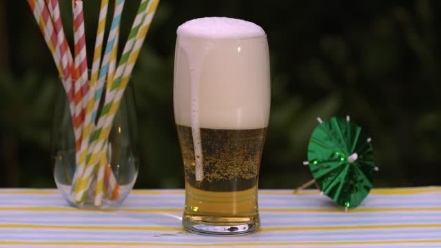 slomo beer foam drips down glass - beer glass stock videos & royalty-free footage