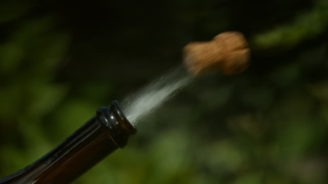 slomo champagne cork explodes from bottle - super slow motion stock videos & royalty-free footage