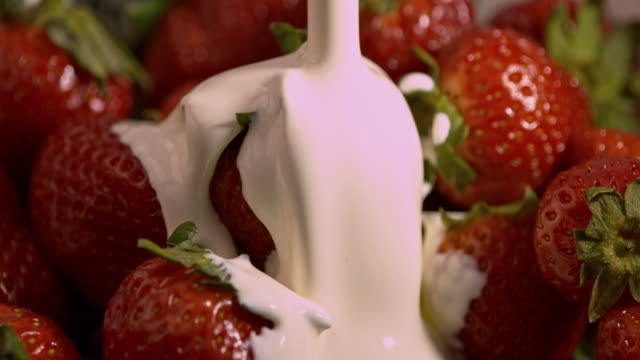 slomo cream pouring on to strawberries - calcium stock videos & royalty-free footage