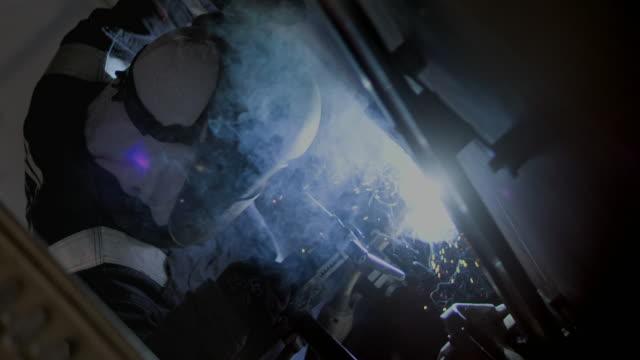 slomo cus welder at work - metal industry stock videos & royalty-free footage