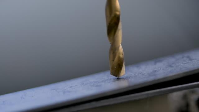 slomo drill bores into metal - spiral stock videos & royalty-free footage