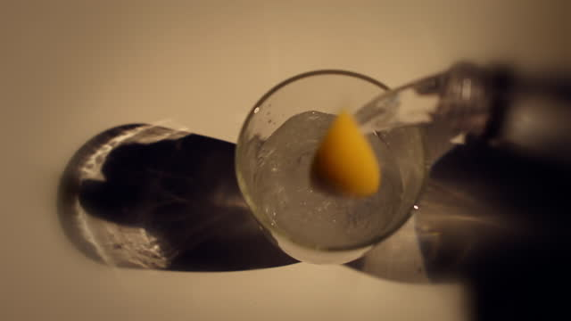 slomo fizzy and alcoholic drinks poured - citrus fruit stock videos & royalty-free footage