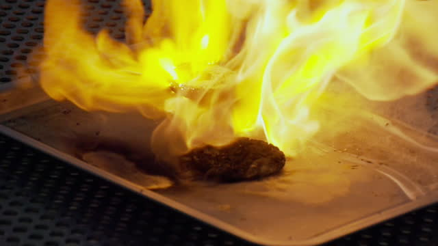 slomo food on fire on baking tray - baking tray stock videos & royalty-free footage