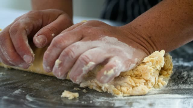 slomo hands kneading pasta dough - italian food stock videos and b-roll footage