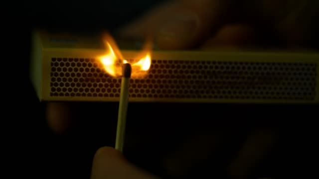 slomo match being struck on a matchbox - flame stock videos & royalty-free footage