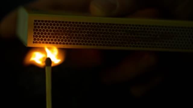 slomo match sparking and lighting on a matchbox - マッチ箱点の映像素材/bロール