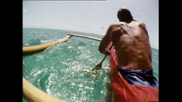slo-mo cu of men paddling hawaiian canoe; 1983 - semi dress stock videos & royalty-free footage