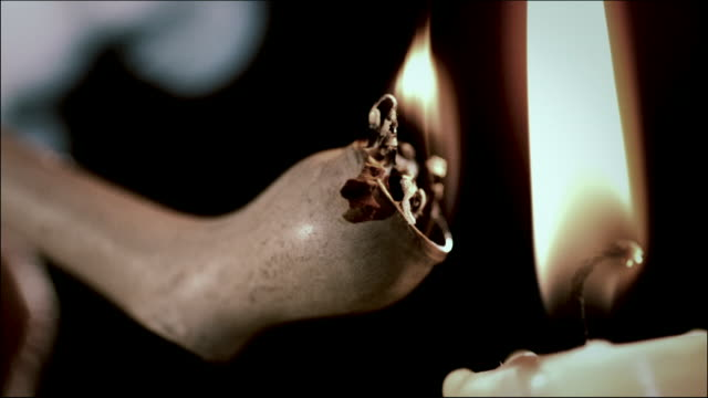 slomo old pipe lit by candle - cancer illness stock videos & royalty-free footage