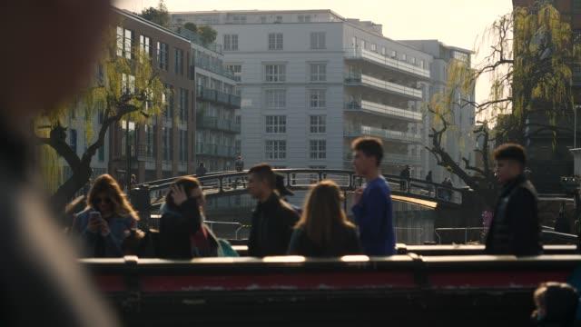 slomo people walk over bridges by camden lock - slow stock videos & royalty-free footage