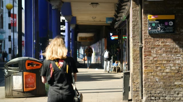 slomo people walking down pavement, brixton - pavement stock videos & royalty-free footage
