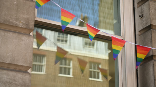 slomo rainbow bunting blows in wind - identity stock videos & royalty-free footage