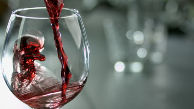 slomo red wine being poured into wine glass - wine glass stock videos & royalty-free footage
