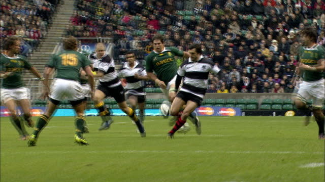 slomo replay of barbarians mitchell scoring a try barbarians v springboks 4th december 2010 available in hd - try scoring stock videos and b-roll footage
