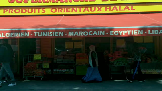 slomo pov shot driving past a minimart in paris - multiculturalism stock videos & royalty-free footage