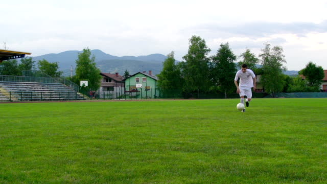 hd: slo-mo shot of soccer goalie in defensive action - kicking stock videos & royalty-free footage