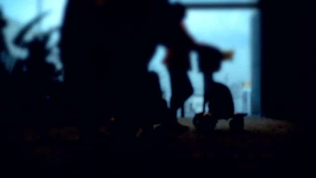 Slo-mo : Silhouettes of passengers at the airport.